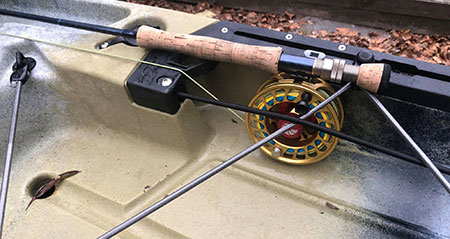 Fly rod in the Outback pocket.