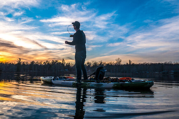 Man fishing from a Jackson Kayak Mayfly.